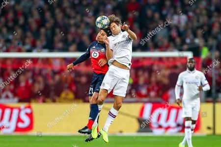 Stock Photo of Chelsea defender Marcos Alonso (3) and Lille midfielder Benjamin Andre (21) clash in the air during the Champions League match between Lille OSC and Chelsea at Stade Pierre Mauroy, Lille