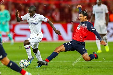 Chelsea midfielder N'golo Kante (7) avoids a tackle from Lille midfielder Benjamin Andre (21) during the Champions League match between Lille OSC and Chelsea at Stade Pierre Mauroy, Lille