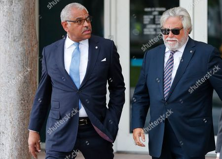 Micky Arison, Arnold Donald. Carnival Corp. CEO Arnold Donald, left, and chairman Micky Arison walk to federal court, in Miami. Top Carnival Corp. executives are back in court to explain what the world's largest cruise line is doing to reduce ocean pollution
