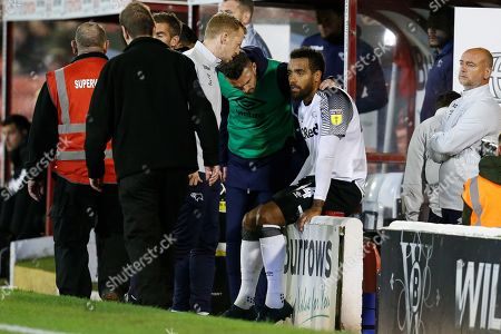 Tom Huddlestone of Derby County goes off injured between Barnsley and Derby County at Oakwell, Barnsley