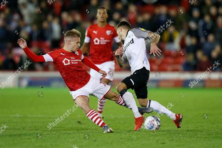 Stock Picture of Luke Thomas of Barnsley F.C. challenges Jamie Paterson of Derby County during the EFL Sky Bet Championship match between Barnsley and Derby County at Oakwell, Barnsley