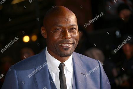 Jimmy Jean-Louis poses for photographers upon arrival at the opening gala of the London Film Festival and the premiere of the film 'The Personal History of David Copperfield' in central London