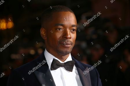 Aki Omoshaybi poses for photographers upon arrival at the opening gala of the London Film Festival and the premiere of the film 'The Personal History of David Copperfield' in central London