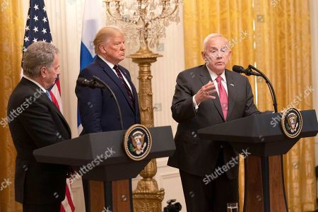 United States Ambassador to Finland Robert Frank Pence, right, makes a statement on the return of remains of Hopi Indians from Finland during a joint news conference with US President Donald Trump, center, and President Sauli Niinisto of Finland, left, at the White House.