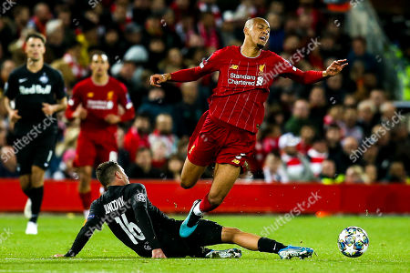 Fabinho of Liverpool is fouled by Zlatko Junuzovic of FC Salzburg