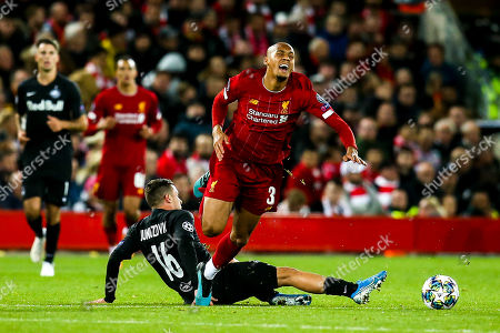 Stock Photo of Fabinho of Liverpool is fouled by Zlatko Junuzovic of FC Salzburg