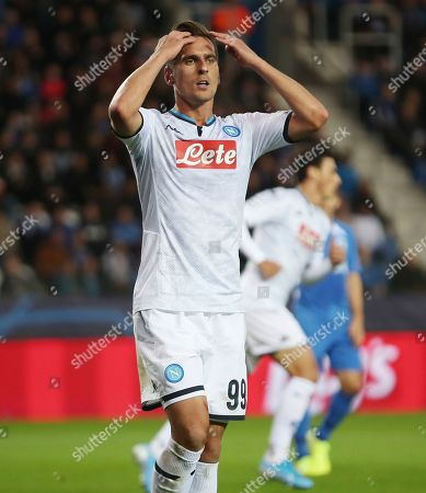 Napoli's Arkadiusz Milik reacts after missing a scoring chance during a Champions League group E soccer match between Genk and Napoli at the KRC Genk Arena in Genk, Belgium
