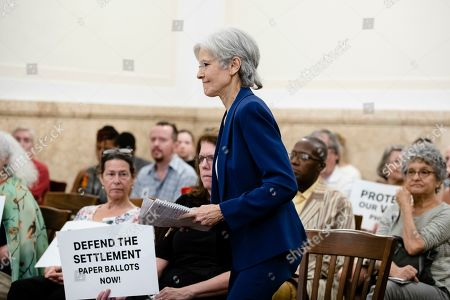 Former Green Party presidential candidate Jill Stein walks to a podium to speak at a board of elections meeting at City Hall, in Philadelphia, . Stein wants Pennsylvania to block Philadelphia from using new touchscreen machines it's buying ahead of 2020's elections and is threatening court action if it doesn't do so promptly