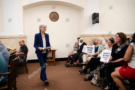 Former Green Party presidential candidate Jill Stein walks from a podium after speaking at a board of elections meeting at City Hall, in Philadelphia, . Stein wants Pennsylvania to block Philadelphia from using new touchscreen machines it's buying ahead of 2020's elections and is threatening court action if it doesn't do so promptly