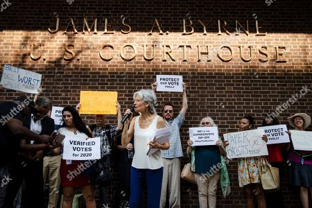 Stock Photo of Former Green Party presidential candidate Jill Stein speaks outside the federal courthouse in Philadelphia, . Stein wants Pennsylvania to block Philadelphia from using new touchscreen machines it's buying ahead of 2020's elections and is threatening court action if it doesn't do so promptly