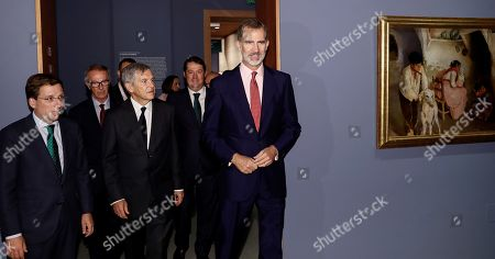 Spain's King Felipe VI (R), curator Javier Baron (C) and Madrid's Mayor Jose Luis Martinez Almeida (L) attend the inauguration of 'Spanish 19th Century Painting. From Goya to Modernism' exhibition at the Maria Cristina Masaveu Peterson Foundation in Madrid, Spain, 02 October 2019.
