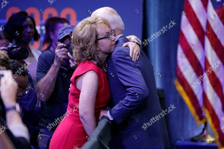 Former Vice President and Democratic presidential candidate Joe Biden, right, hugs former Rep. Gabby Giffords during a gun safety forum, in Las Vegas