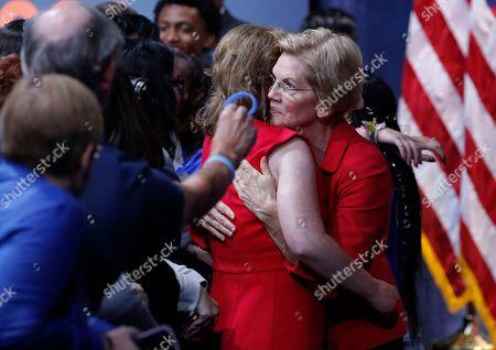Stock Photo of Democratic presidential candidate Sen. Elizabeth Warren, D-Mass., right, hugs former Rep. Gabby Giffords during a gun safety forum, in Las Vegas