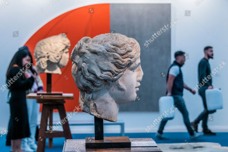 Stock Image of Old and new - Head of Apollo in Galerie Chenel with Red/Grey Zone by Robert Mangold in the background at Regents Park