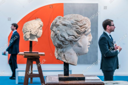Stock Picture of Old and new - Head of Apollo in Galerie Chenel with Red/Grey Zone by Robert Mangold in the background at Regents Park