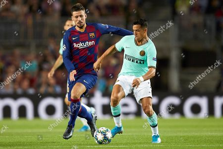 FC Barcelona's Clement Lenglet (L) in action against Internazionale's Alexis Sanchez (R) during  the UEFA Champions League group F soccer match between FC Barcelona and FC Internazionale at Camp Nou Stadium in Barcelona, Catalonia, Spain, 02 October 2019.