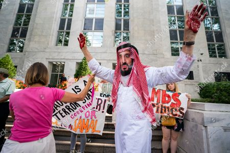 David Barrows (R), an activist with Code Pink, dresses as Prince Mohammed bin Salman of Saudi Arabia during a rally to 'honor the memory of murdered Washington Post columnist Jamal Khashoggi? outside the embassy of Saudi Arabia in Washington, DC, USA, 02 October 2019. Saudi agents murdered Khashoggi at a Saudi consulate in Turkey one year ago today.