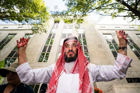 David Barrows, an activist with Code Pink, dresses as Prince Mohammed bin Salman of Saudi Arabia during a rally to 'honor the memory of murdered Washington Post columnist Jamal Khashoggi? outside the embassy of Saudi Arabia in Washington, DC, USA, 02 October 2019. Saudi agents murdered Khashoggi at a Saudi consulate in Turkey one year ago today.