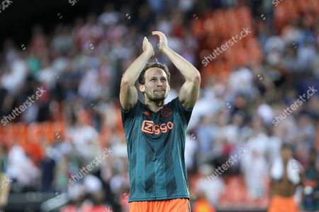 Ajax's Daley Blind celebrates his team victory after the Champions League group H soccer match between Valencia and Ajax, at the Mestalla stadium in Valencia, Wednesday, Oct.2, 2019