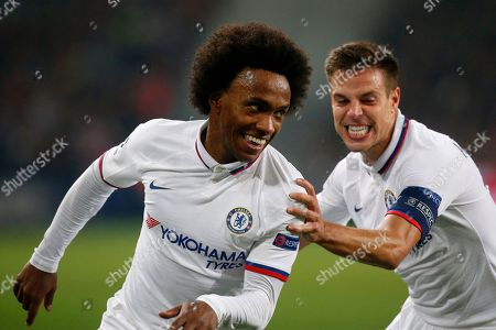 Chelsea's Willian, left, celebrates with Chelsea's Cesar Azpilicueta after scoring his side's second goal during the group H Champions League soccer match between Lille and Chelsea at the Stade Pierre Mauroy - Villeneuve d'Ascq stadium in Lille, France