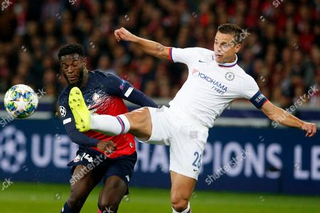 Lille's Jonathan Bamba, left, fights for the ball with Chelsea's Cesar Azpilicueta during the group H Champions League soccer match between Lille and Chelsea at the Stade Pierre Mauroy - Villeneuve d'Ascq stadium in Lille, France