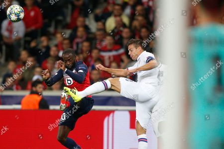 Lille's Jonathan Ikone, left, fights for the ball with Chelsea's Cesar Azpilicueta during the group H Champions League soccer match between Lille and Chelsea at the Stade Pierre Mauroy - Villeneuve d'Ascq stadium in Lille, France
