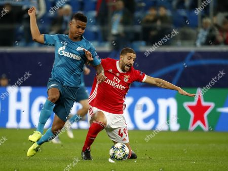 Adel Taarabt (R) of Benfica in action against Wilmar Barrios of Zenit during the UEFA Champions League match between Zenit St.Petersburg and SL Benfica in St.Petersburg, Russia, 02 October 2019.