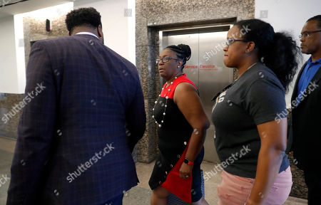 Allison Jean, Lee Merritt. Allison Jean, left, center, mother of Botham Jean, leaves court with attorney Lee Merritt, left, and others during a lunch break in the punishment phase in the trial of former Dallas police officer Amber Guyger, in Dallas. Guyger, who said she fatally shot her unarmed black neighbor Botham Jean after mistaking his apartment for her own, was found guilty of murder the day before