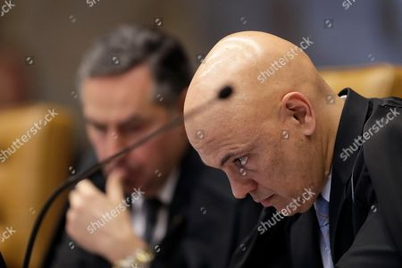 Stock Image of Brazil's Supreme Court Minister Alexandre de Moraes joins the court session to resume the case that could lead to the annulment of dozens of cases brought by the sprawling Operation Car Wash anti-corruption probe, in Brasilia, Brazil, . The probe, once heralded as a model of anti-corruption efforts, has been heavily criticized in Brazil following allegations that some prosecutions were politically tainted