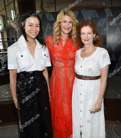 Elizabeth Chai Vasarhelyi, Laura Dern, Lisa Pelikan. Director-producer Elizabeth Chai Vasarhelyi, left, actor Laura Dern and actor Lisa Pelikan pose together at the Academy of Motion Picture Arts and Sciences Women's Initiative New York luncheon at the Rainbow Room, in New York