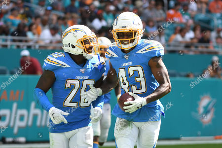 Stock Image of Michael Davis #43 of Los Angeles is congratulated by Desmond King II #20 after intercepting a pass during the NFL football game between the Miami Dolphins and Los Angeles Chargers at Hard Rock Stadium in Miami Gardens FL. The Chargers defeated the Dolphins 30-10