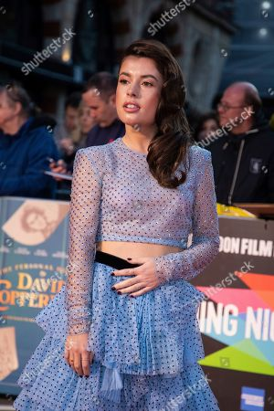 Aimee Kelly poses for photographers upon arrival at the opening gala of the London Film Festival and the premiere of the film 'The Personal History of David Copperfield' in central London