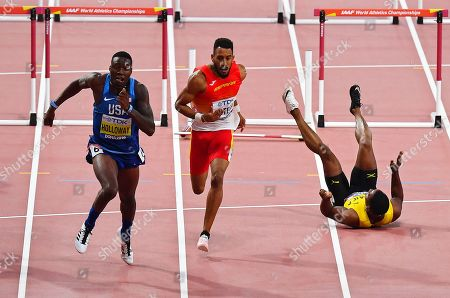 Grant Holloway (L) of the USA is on his way to win the men's 110m Hurdles final as Jamaica's Omar McLeod (R) falls at the IAAF World Athletics Championships 2019 at the Khalifa Stadium in Doha, Qatar, 02 October 2019.