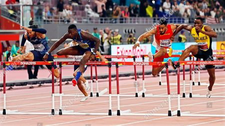 Stock Photo of Grant Holloway (2-L) of the USA is on his way to win the men's 110m Hurdles final as Omar McLeod (R) of Jamaica hinders Orlando Ortega (2-R) of Spain during the men's 110m Hurdles final at the IAAF World Athletics Championships 2019 at the Khalifa Stadium in Doha, Qatar, 02 October 2019.