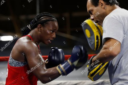 Claressa Shields, John David Jackson. Claressa Shields spars with trainer John David Jackson during a training session, in Detroit. Shields will fight Croatian boxer Ivana Habazin for the vacant World Boxing Organization Junior Middleweight title in Flint, Mich., on Saturday night