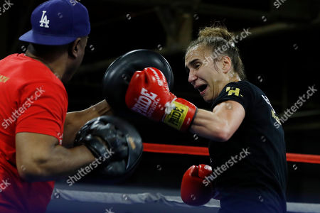 Croatian boxer Ivana Habazin spars with trainer James Ali Bashir during a training session, in Detroit. Habazin will fight Claressa Shields for the vacant World Boxing Organization Junior Middleweight title in Flint, Mich., on Saturday night