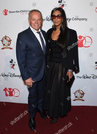 """Wolfgang Puck, Gelila Assefa. Wolfgang Puck, left, and Gelila Assefa arrive at the Save the Children """"Centennial Celebration: Once in a Lifetime"""" event, at The Beverly Hilton Hotel in Beverly Hills, Calif"""