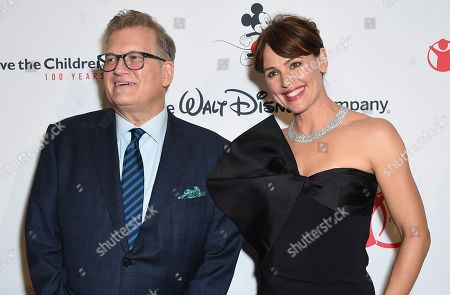 """Stock Image of Drew Carey, Jennifer Garner. Drew Carey, left, and Jennifer Garner arrive at the Save the Children """"Centennial Celebration: Once in a Lifetime"""" event, at The Beverly Hilton Hotel in Beverly Hills, Calif"""