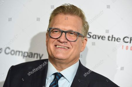 """Stock Photo of Drew Carey arrives at the Save the Children """"Centennial Celebration: Once in a Lifetime"""" event, at The Beverly Hilton Hotel in Beverly Hills, Calif"""
