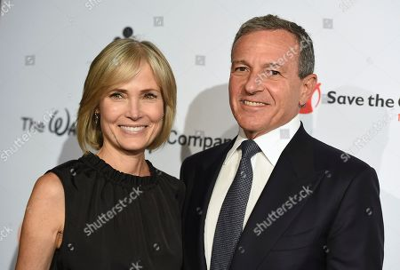 "Robert Iger, Willow Bay. Willow Bay, left, and Disney CEO Robert Iger arrive at the Save the Children ""Centennial Celebration: Once in a Lifetime"" event, at The Beverly Hilton Hotel in Beverly Hills, Calif"