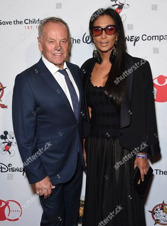 """Stock Picture of Wolfgang Puck, Gelila Assefa. Wolfgang Puck, left, and Gelila Assefa arrive at the Save the Children """"Centennial Celebration: Once in a Lifetime"""" event, at The Beverly Hilton Hotel in Beverly Hills, Calif"""