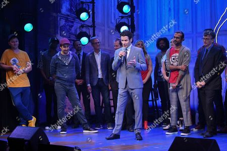"""Lin-Manuel Miranda, Thomas Kail, Utkarsh Ambudkar, Beowulf Borritt. Director Thomas Kail, center, addresses the audience during the opening night curtain call for """"Freestyle Love Supreme"""" at the Booth Theatre, in New York"""