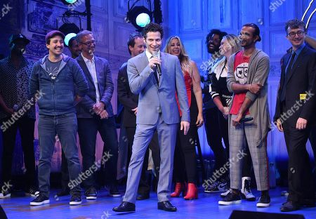 """Lin-Manuel Miranda, Thomas Kail, Utkarsh Ambudkar. Director Thomas Kail, center, addresses the audience during the opening night curtain call for """"Freestyle Love Supreme"""" at the Booth Theatre, in New York"""