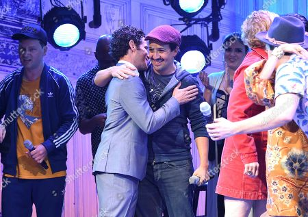"""Thomas Kail, Lin-Manuel Miranda. Director Thomas Kail, center left, and actor Lin-Manuel Miranda, center right, appear onstage during the opening night curtain call for """"Freestyle Love Supreme"""" at the Booth Theatre, in New York"""