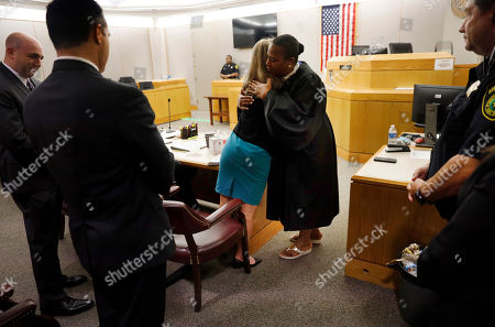 Stock Image of Former Dallas Police Officer Amber Guyger gives State District Judge Tammy Kemp a hug after the judge had given her a Bible and before Guyger left for jail, Wednesday, Oct. 2, 2019, in Dallas. Guyger, who said she mistook neighbor Botham Jean's apartment for her own and fatally shot him in his living room, was sentenced to a decade in prison. (Tom Fox/The Dallas Morning News via AP, Pool)