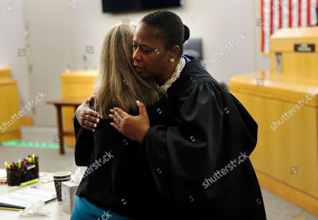 Stock Picture of State District Judge Tammy Kemp gives former Dallas Police Officer Amber Guyger a hug before Guyger leaves for jail, Wednesday, Oct. 2, 2019, in Dallas. Guyger, who said she mistook neighbor Botham Jean's apartment for her own and fatally shot him in his living room, was sentenced to a decade in prison. (Tom Fox/The Dallas Morning News via AP, Pool)