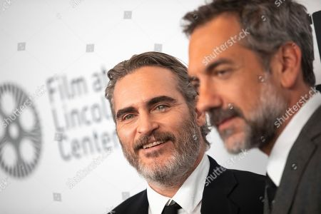 """Joaquin Phoenix, Todd Phillips. Actor Joaquin Phoenix, left, and director Todd Phillips attend the """"Joker"""" premiere at Alice Tully Hall during the 57th New York Film Festival, in New York"""