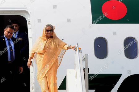 Prime Minister of Bangladesh Sheikh Hasina (R) exits an airliner upon her arrival at the Indira Gandhi International Airport in New Delhi, India, 03 October 2019. Prime Minister Sheikh Hasina on a four-day official visit to India and is scheduled to hold talks with her Indian counterpart Narendra Modi on 05 October 2019.