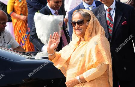 Prime Minister of Bangladesh Sheikh Hasina waves to the media upon her arrival at the Indira Gandhi International Airport in New Delhi, India, 03 October 2019. Prime Minister Sheikh Hasina on a four-day official visit to India and is scheduled to hold talks with her Indian counterpart Narendra Modi on 05 October 2019.
