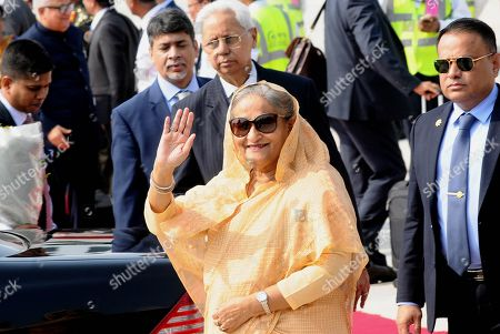 Prime Minister of Bangladesh Sheikh Hasina (C) waves to the media upon her arrival at the Indira Gandhi International Airport in New Delhi, India, 03 October 2019. Prime Minister Sheikh Hasina on a four-day official visit to India and is scheduled to hold talks with her Indian counterpart Narendra Modi on 05 October 2019.